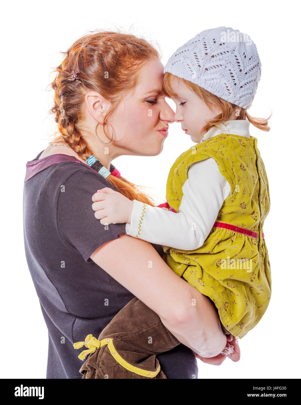 Mother with daughter sharing secrets isolated on white - Stock Image
