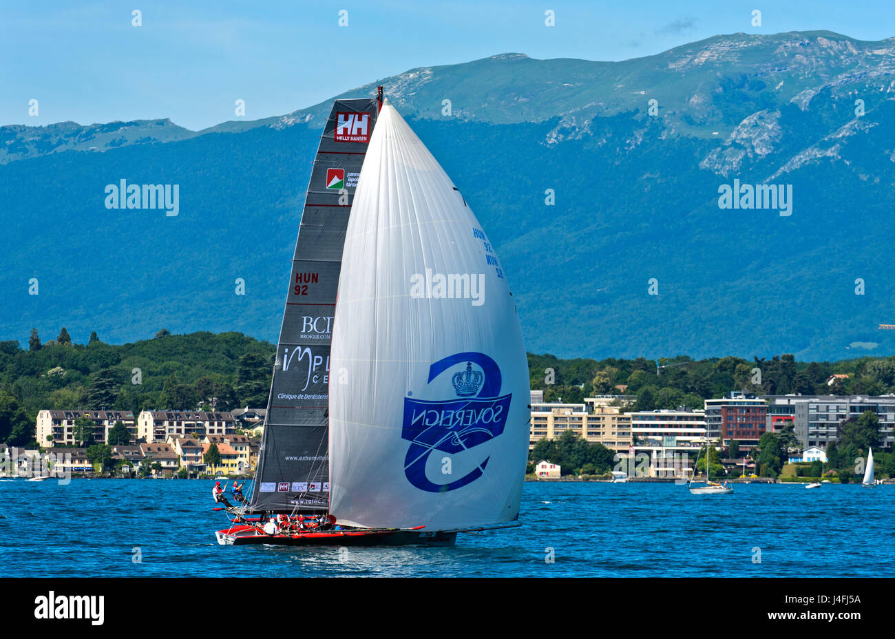 Sailing boat flying a spinnaker sail on Lake Geneva, boat HUN 92 Implant Centre Raffica, Bol d'Or Mirabaud regatta, - Stock Image