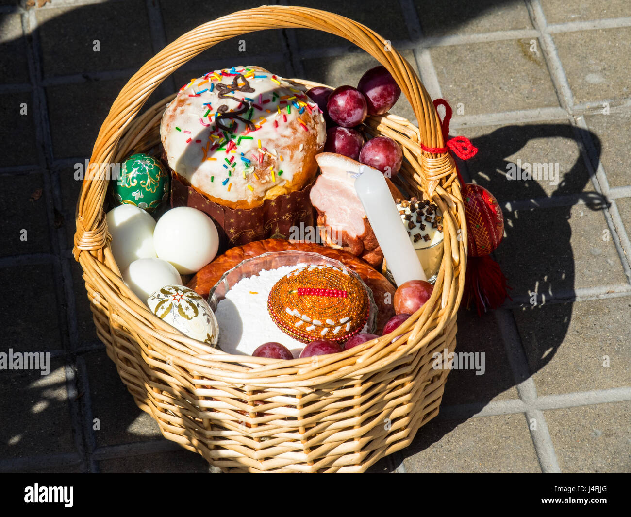 A cane basket filled with easter offerings of eggs and cakes to a cane basket filled with easter offerings of eggs and cakes to celebrate the russian orthodox easter negle Image collections