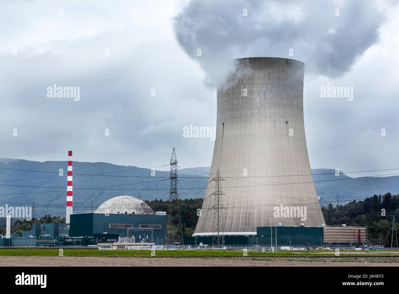 Cooling tower of a nuclear power station. - Stock Image