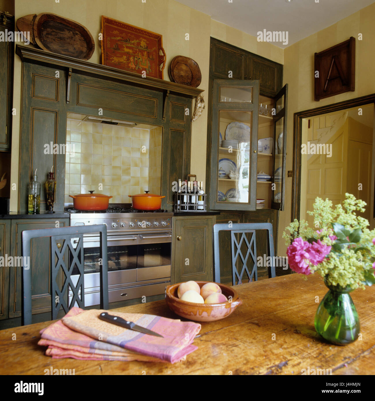 Kitchen table in front of stove - Stock Image