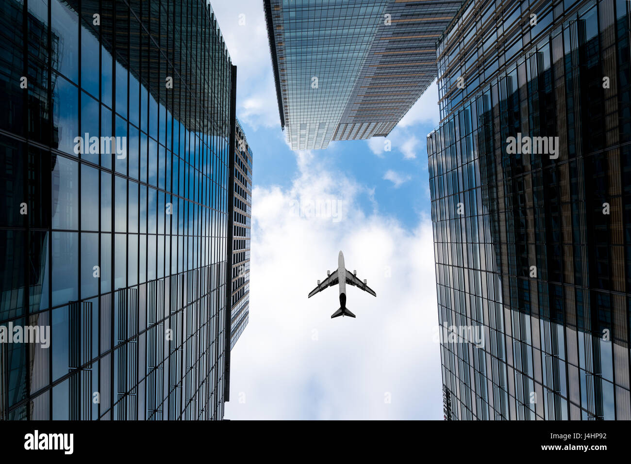 Tokyo skyscrapers buildings and a plane flying overhead at in Tokyo Shinjuku downtown and business district in morning Stock Photo