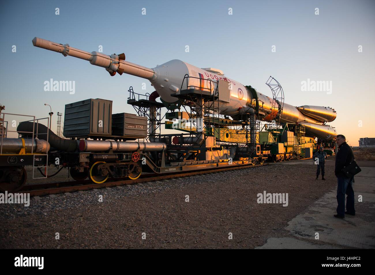 A train rolls the Soyuz MS-04 spacecraft rocket to the Baikonur Cosmodrome launch pad in preparation for the NASA - Stock Image