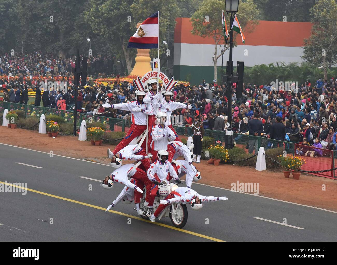 The Indian Army Corps of Signals contingent perform daredevil stunts on motorbikes down the Rajpath ceremonial boulevard - Stock Image
