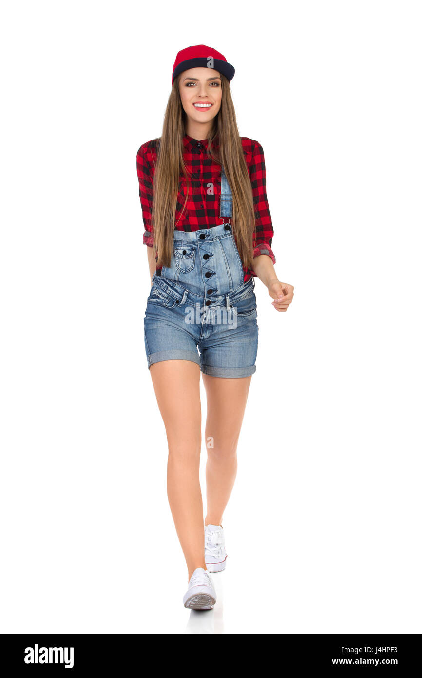 Woman In Red Lumberjack Shirt Jeans Shorts White Sneakers And Full
