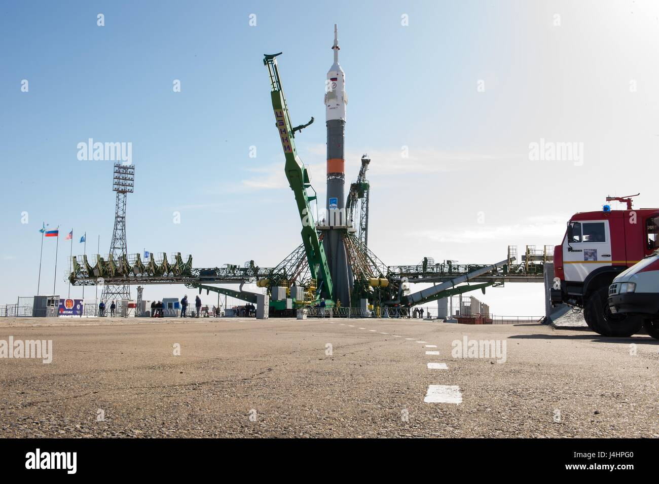The Soyuz MS-04 spacecraft rocket is raised into the vertical position at the Baikonur Cosmodrome launch pad in - Stock Image