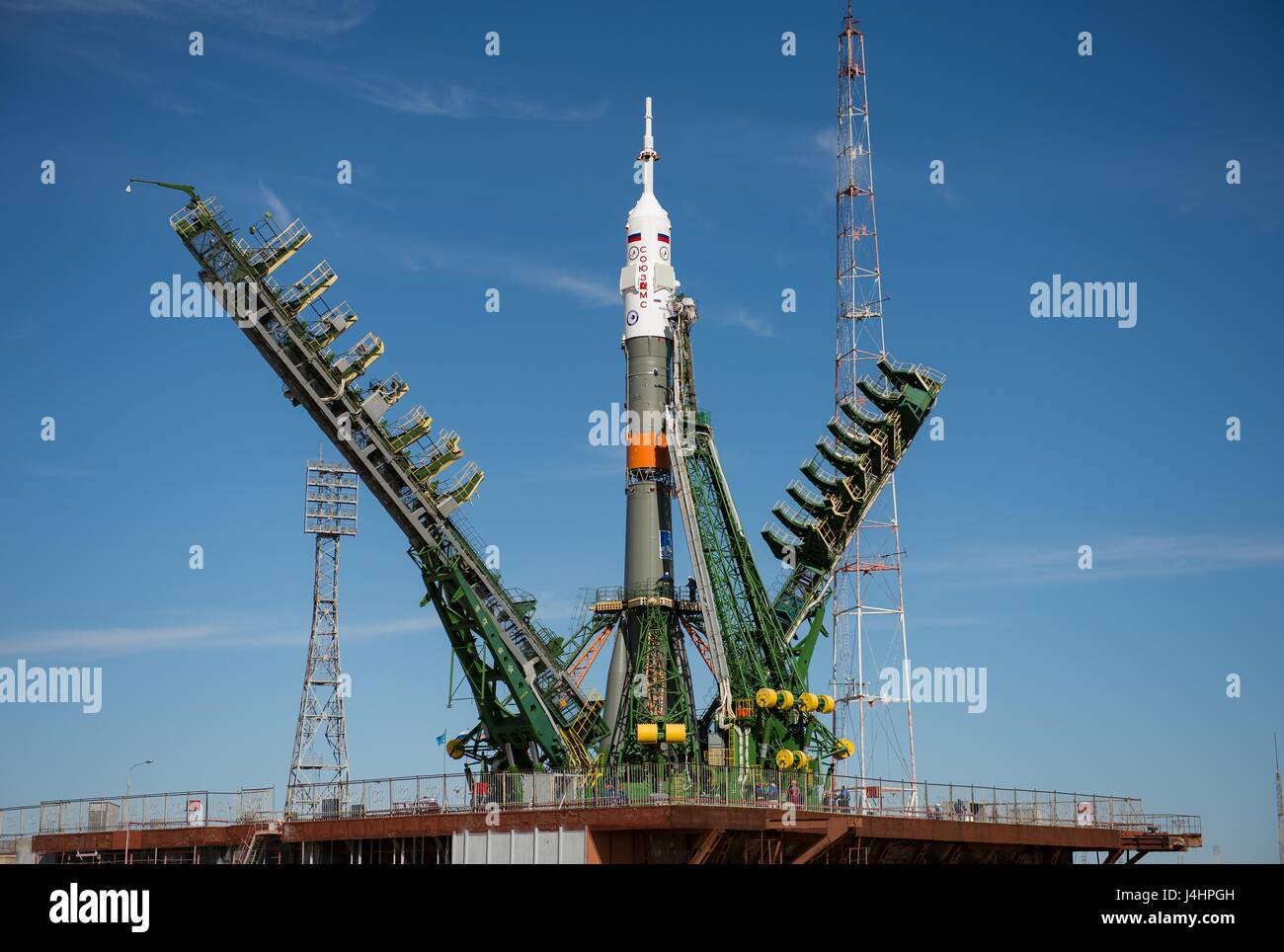 Gantry arms close around the Soyuz MS-04 spacecraft rocket to secure its vertical position on the Baikonur Cosmodrome - Stock Image