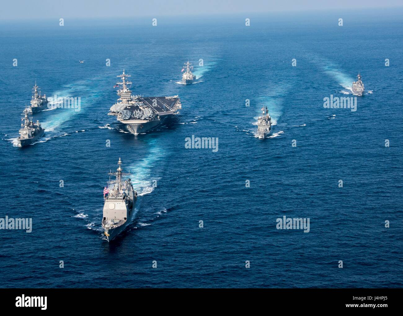 The USN Ticonderoga-class guided-missile cruiser USS Lake Champlain leads U.S. and Japanese warships in formation Stock Photo