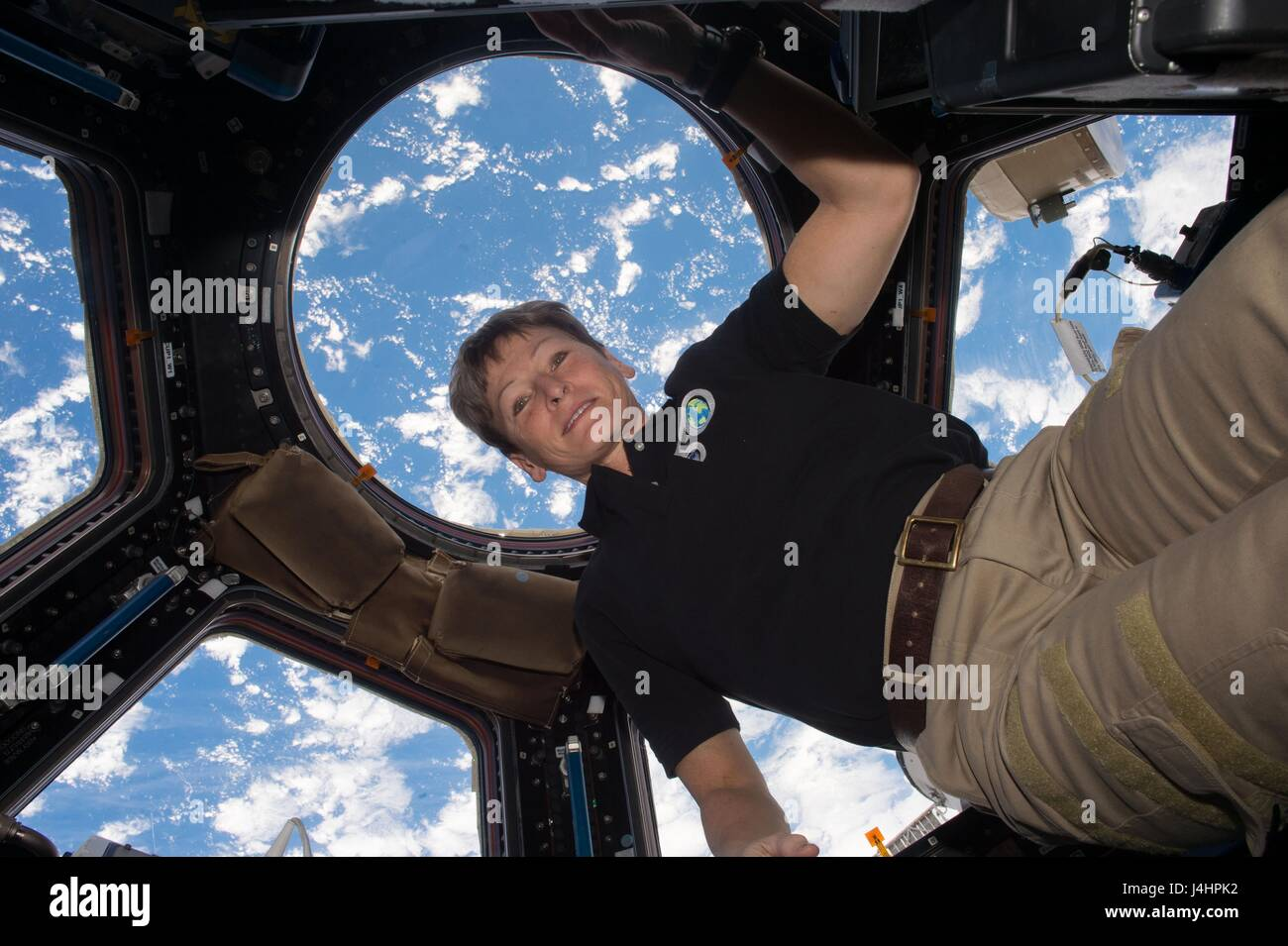 NASA International Space Station Expedition 50 prime crew member astronaut Peggy Whitson floats next to the cupola - Stock Image