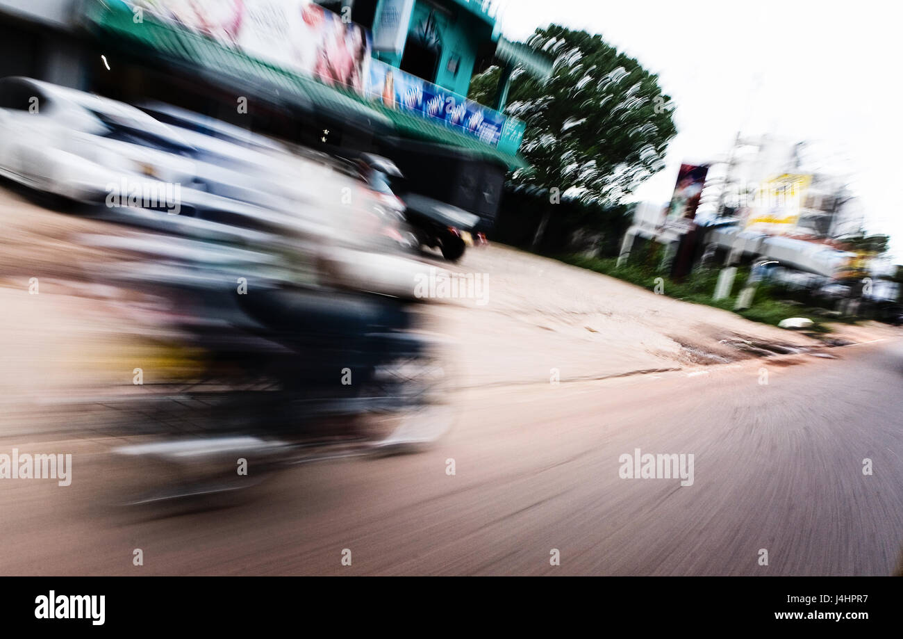 The motorcycle rides on the road at a fast speed. Motion blur. - Stock Image