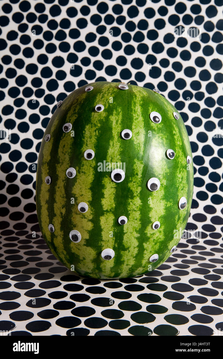 watermelon transform into a freak on a dots background - Stock Image