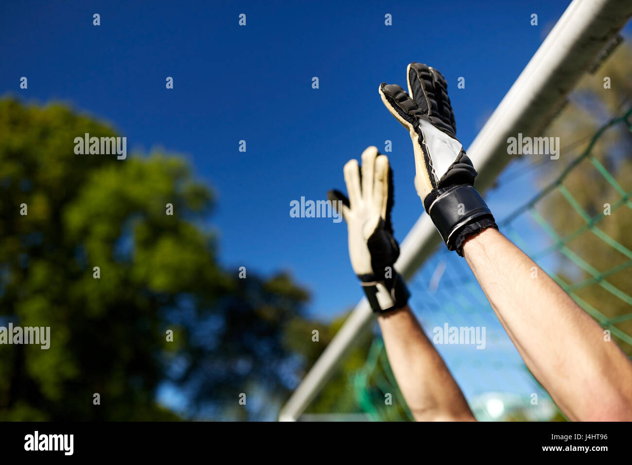 goalkeeper or soccer player at football goal - Stock Image