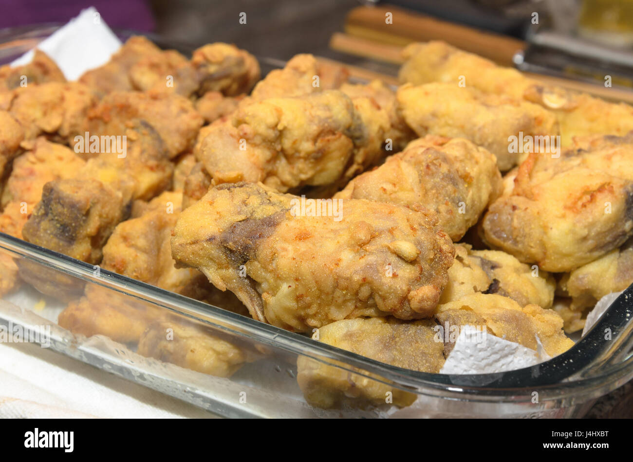 Pintado fish fried and breaded. Slices of fish fried on hot oil. - Stock Image
