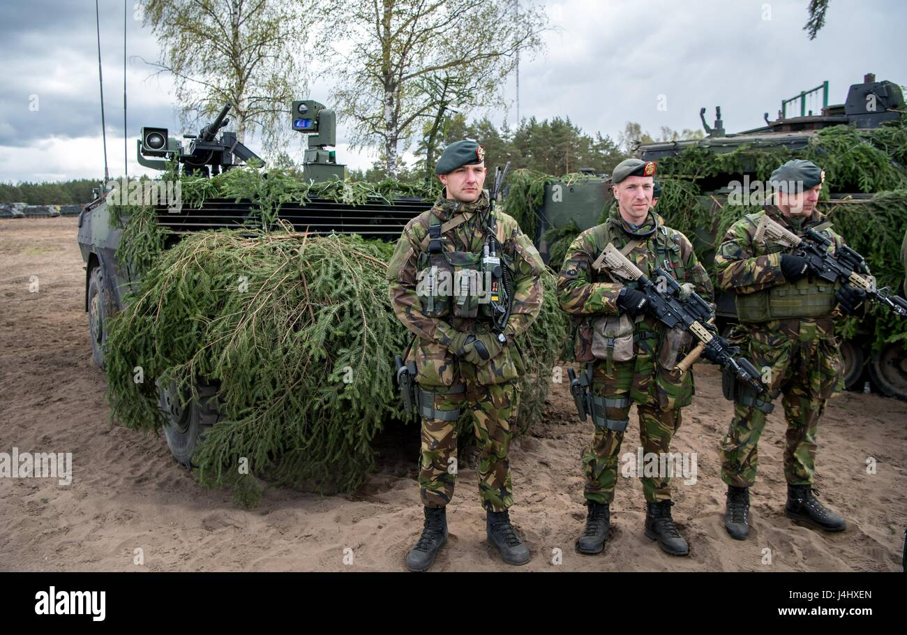 British soldiers in full battle uniform stand for review during a NATO training exercise at the Pabrade Training - Stock Image