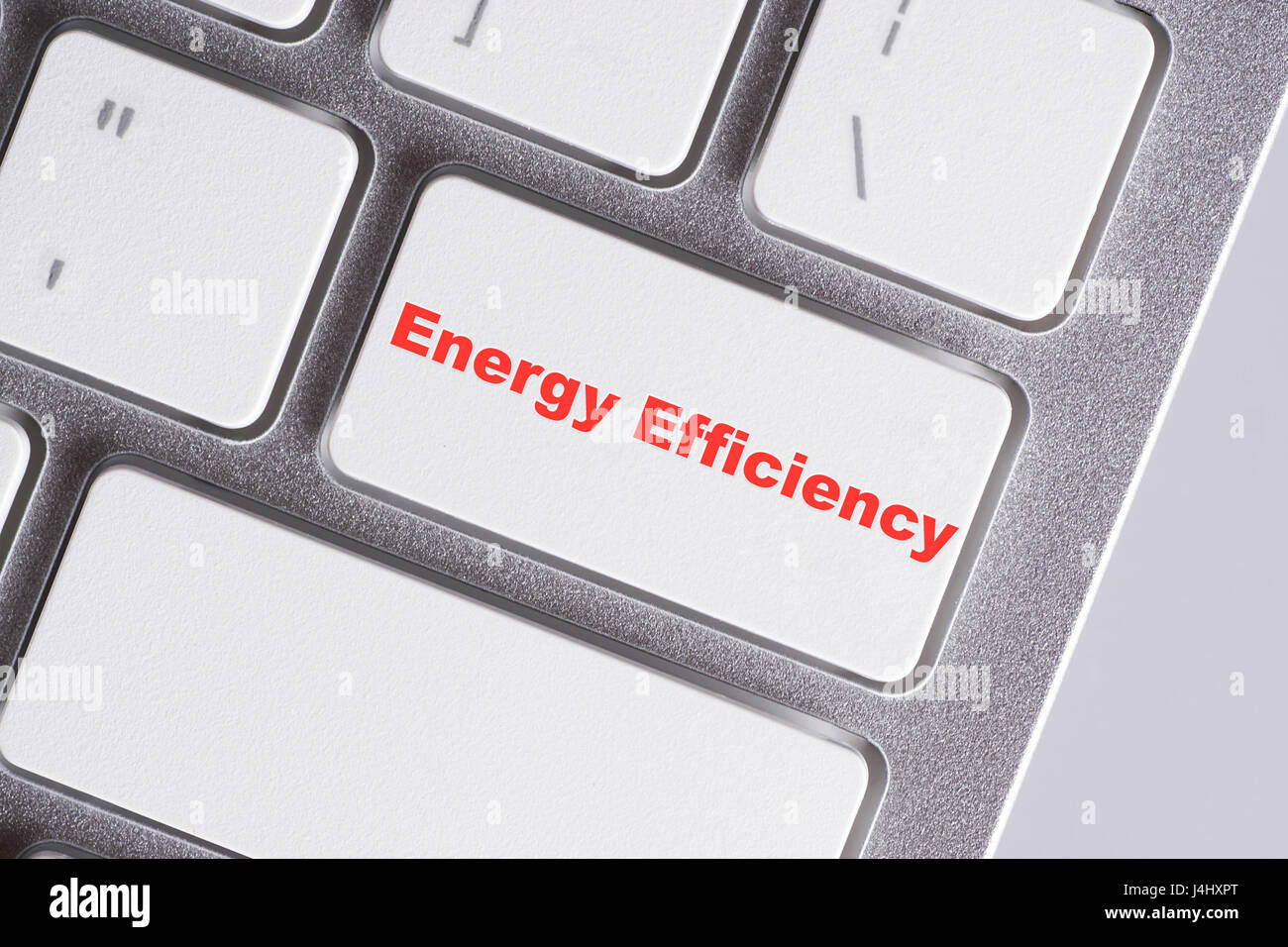 'Energy efficiency' red words on white keyboard - online, education and business concept - Stock Image