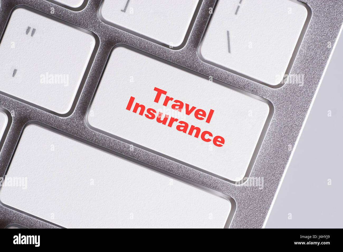 'Travel Insurance' red words on white keyboard - online, education and business concept - Stock Image