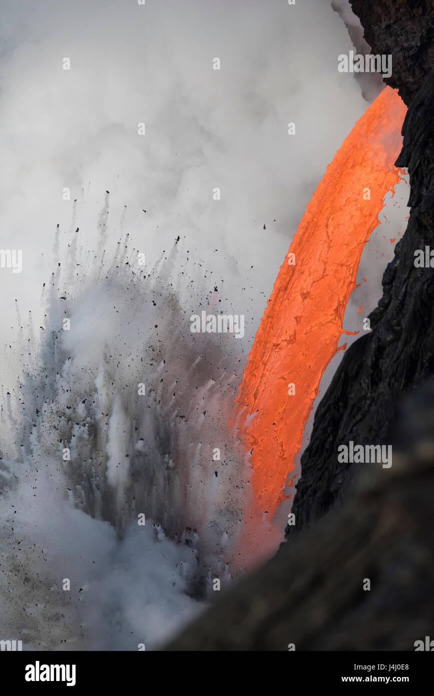 hot lava from from Kilauea Volcano creates steam explosion at Kamokuna ocean entry in Hawaii Volcanoes National - Stock Image
