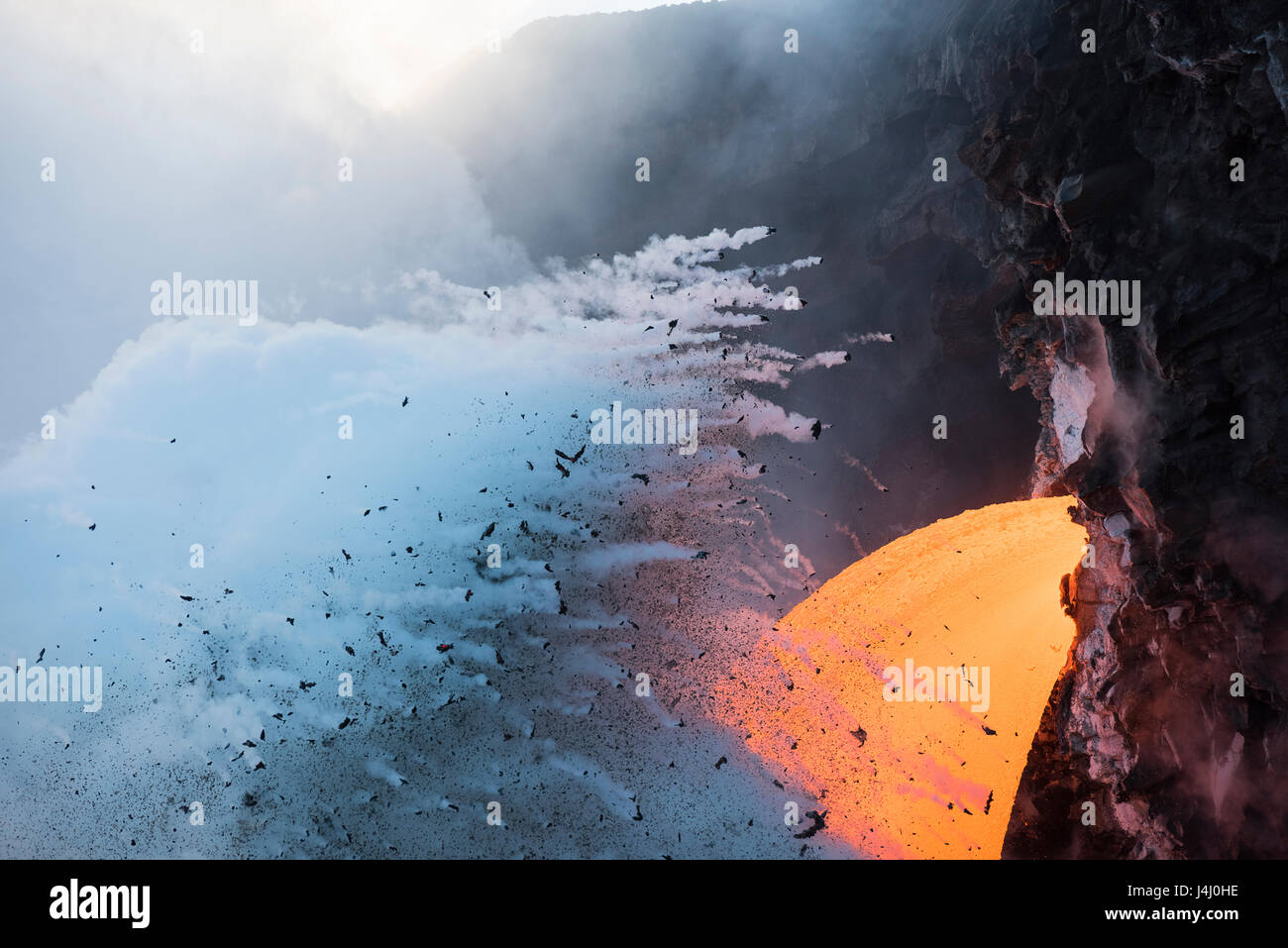 steam explosions where hot lava from Kilauea Volcano enters the ocean at the 61G Kamokuna entry in Hawaii Volcanoes - Stock Image