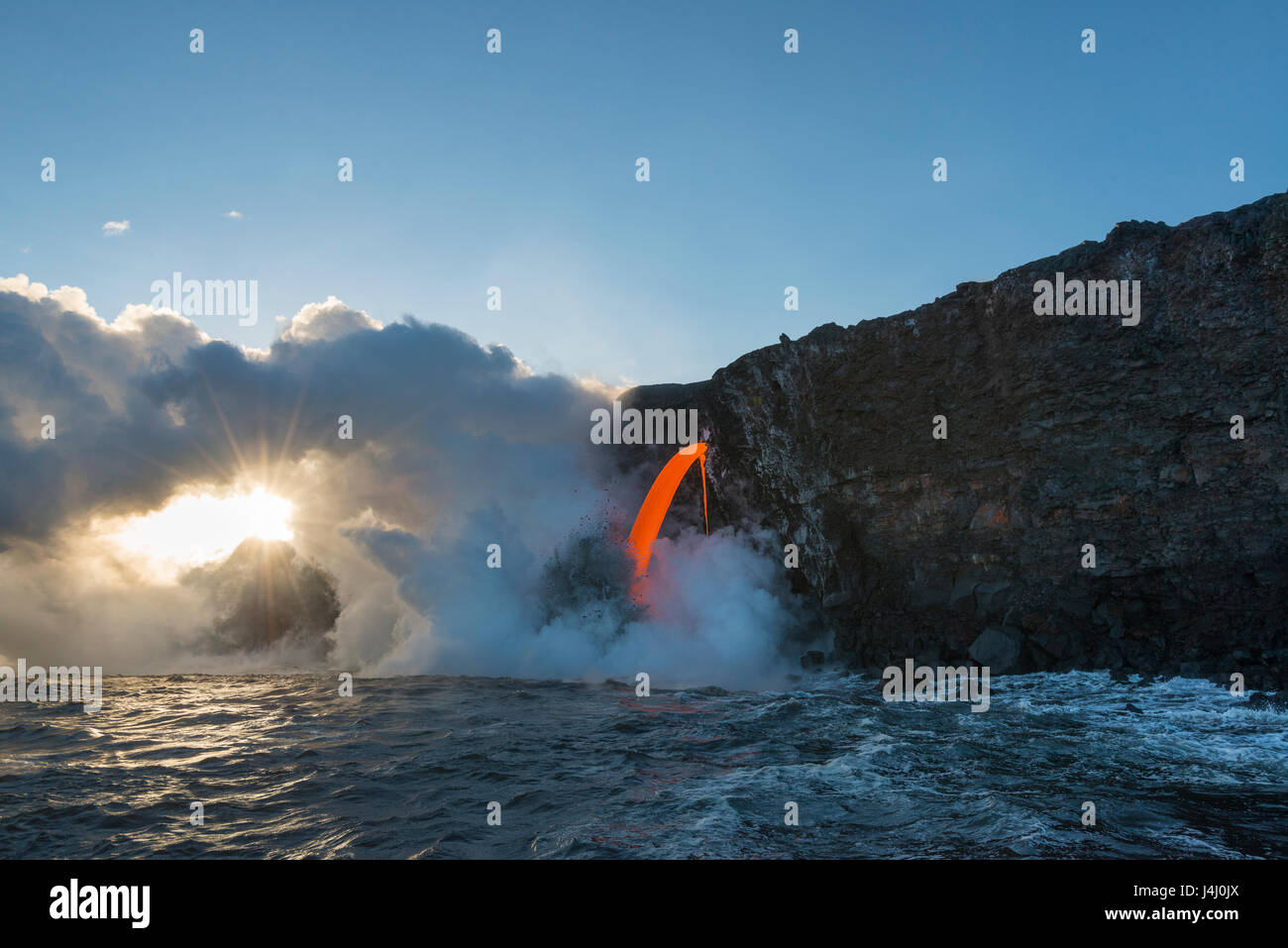 hot lava from the 61G flow from Kilauea Volcano enters the ocean at the Kamokuna entry in Hawaii Volcanoes National - Stock Image