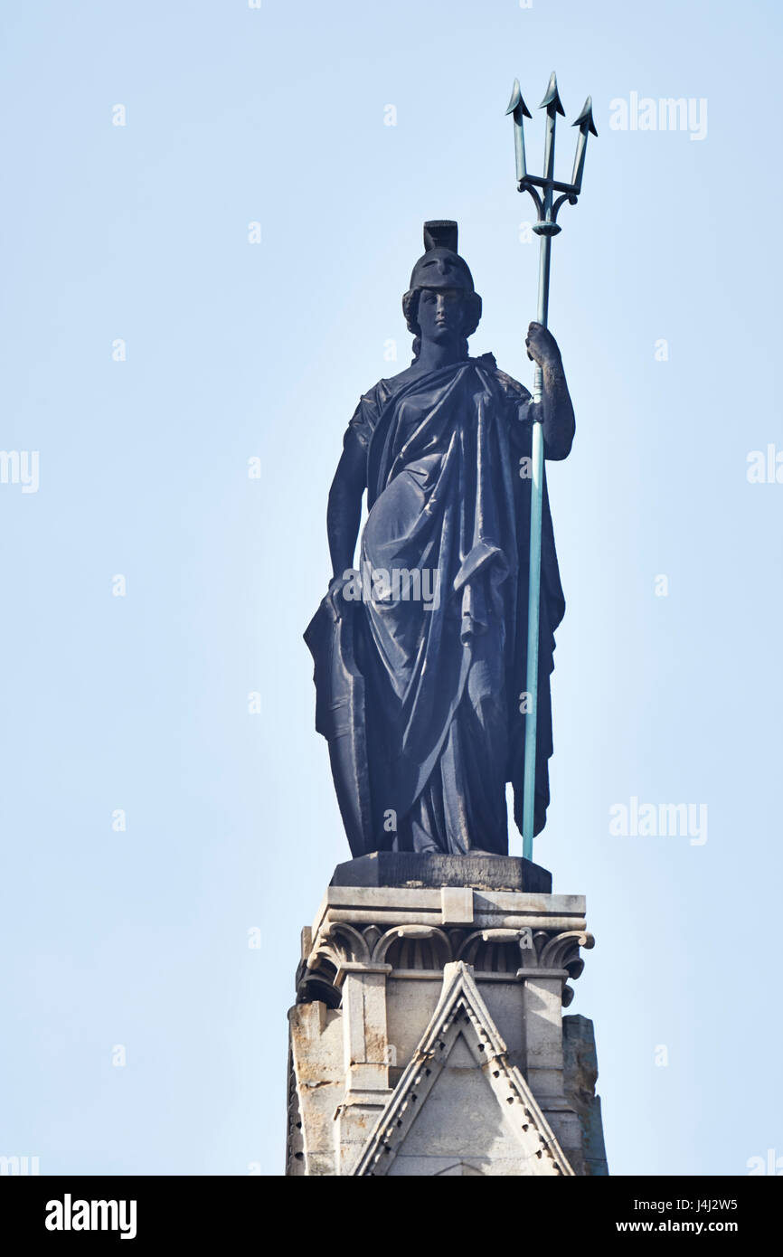 Figure of Britannia with trident, on the clock tower of the Midland Grand Hotel at St Pancras in London, designed - Stock Image