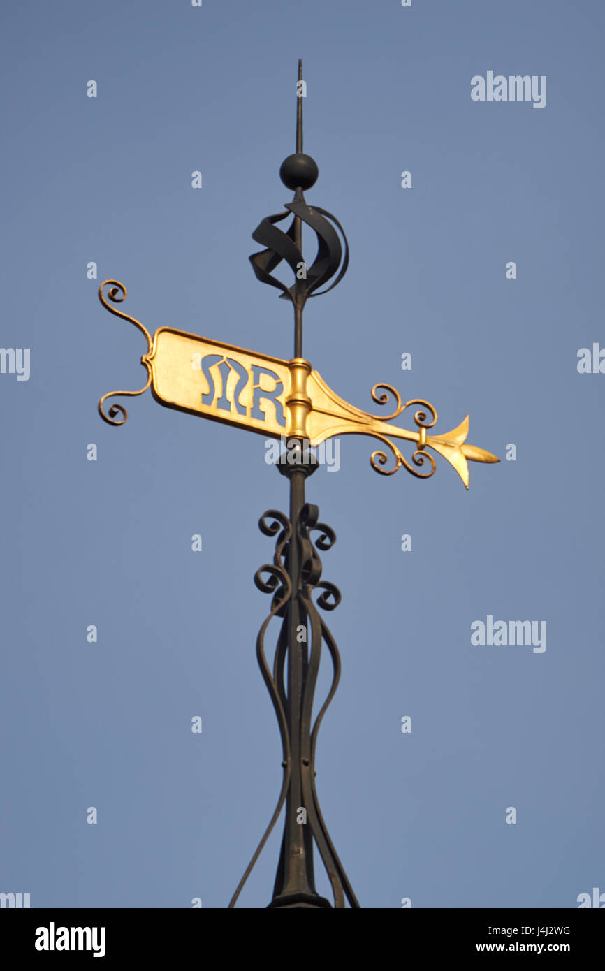 Gilded weathervane with letters MR, for the Midland Railway., on wrought iron support. Detail of Midland Grand Hotel - Stock Image