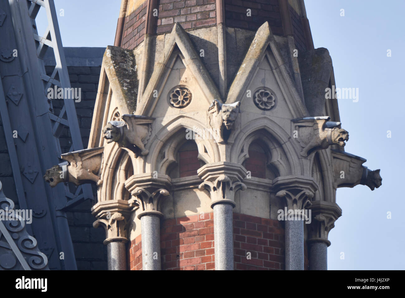 Detail of pinnacle on the clock tower, Midland Grand Hotel at St Pancras Station, London. With marble shafts, stone - Stock Image