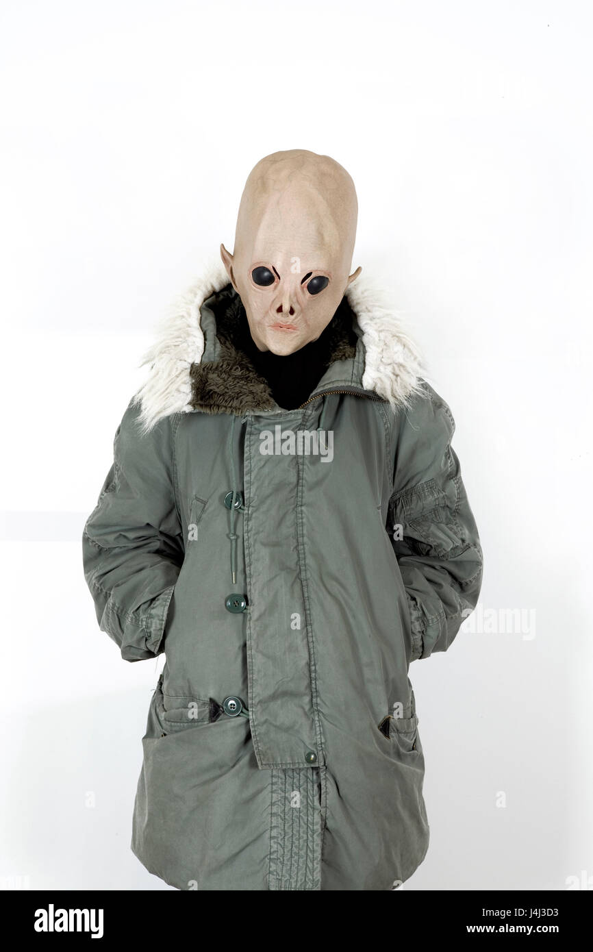 Alien wearing a military coat with hood fake fur - Stock Image