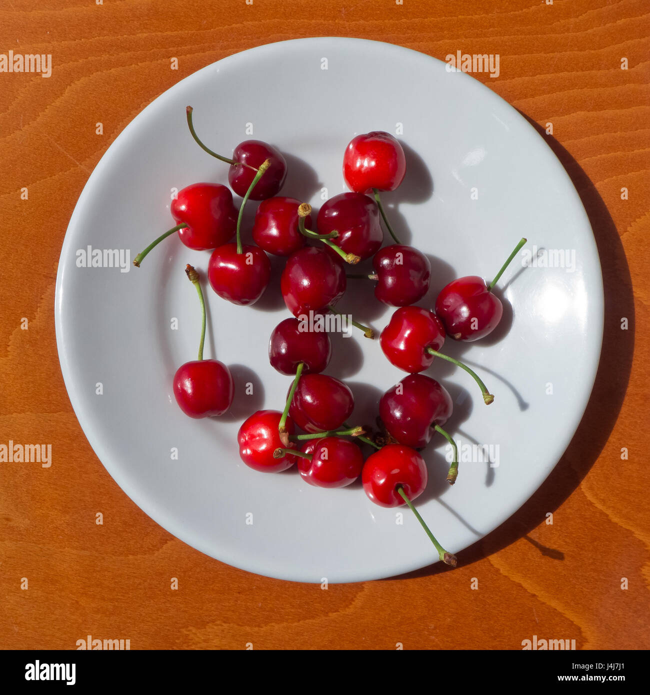 Cherries in the dish to eating. - Stock Image