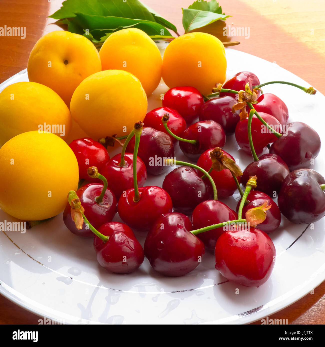 Apricots and fresh cherries. - Stock Image