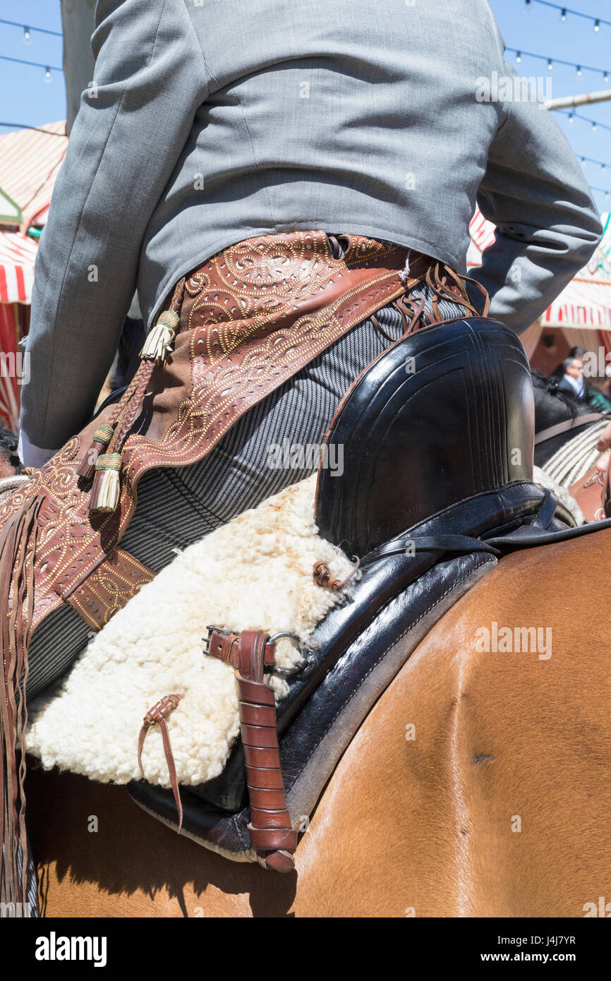 Seville, Seville Province, Andalusia, southern Spain.  Feria de Abril, the April Fair.  Horse rider wearing tooled - Stock Image