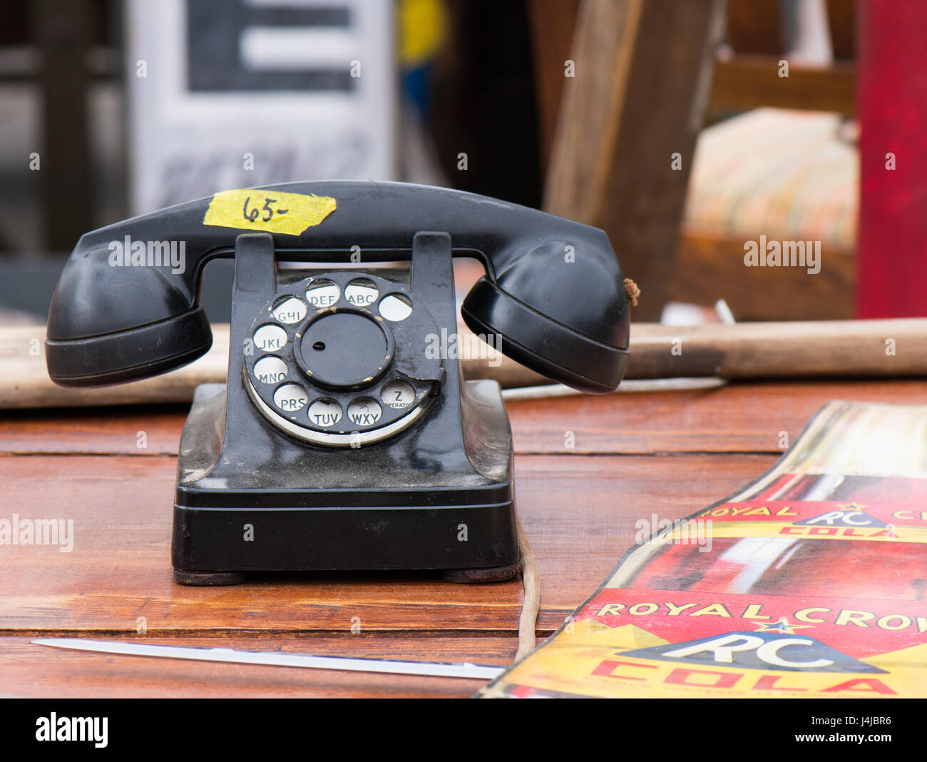Old rotary telephone at antique market. - Stock Image