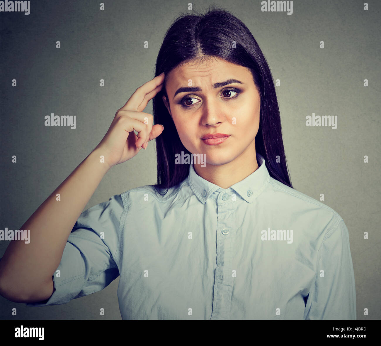 Worried pensive young woman thinking - Stock Image