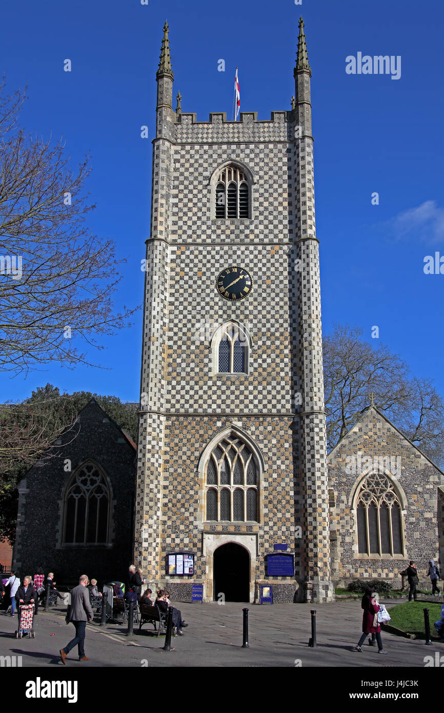 Reading Minster bell tower at 'The Butts' in Reading with its ornate stone and flint constructed tower and - Stock Image