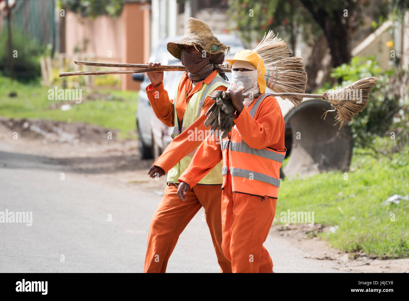 Ethiopian Street Cleaner in uniform walking on road in Addis Ababa - Stock Image