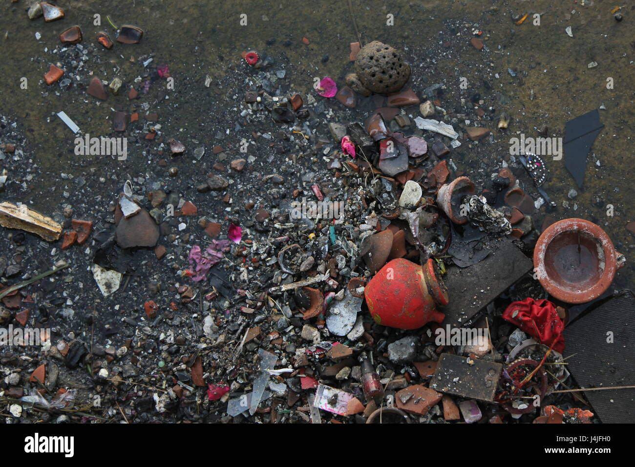 Beautiful debris washed up on the steps of a holy lake in Pushkar, Rajasthan, India. - Stock Image