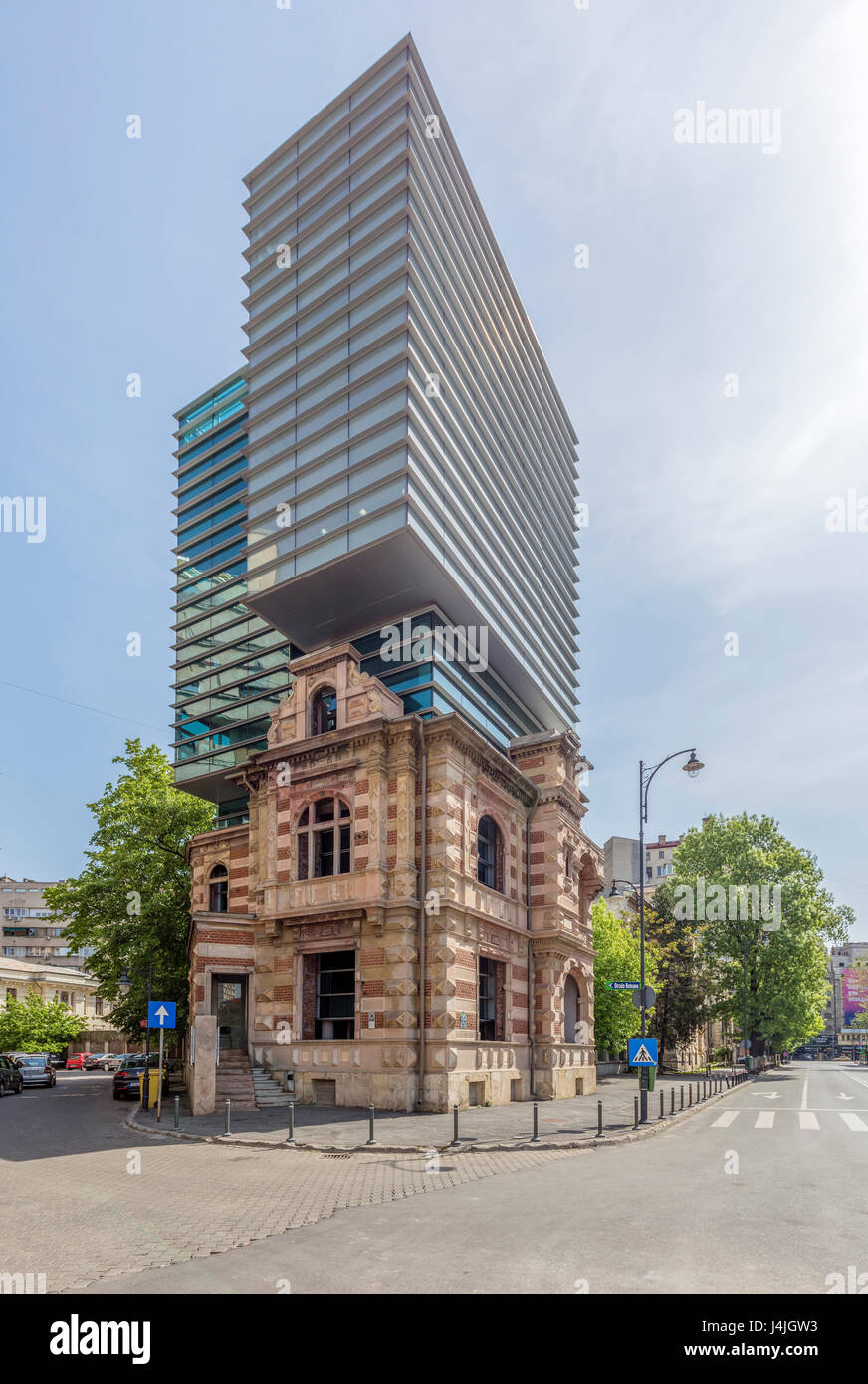 Office building in the downtown of Bucharest. The original old building was the headquarter of National Security - Stock Image