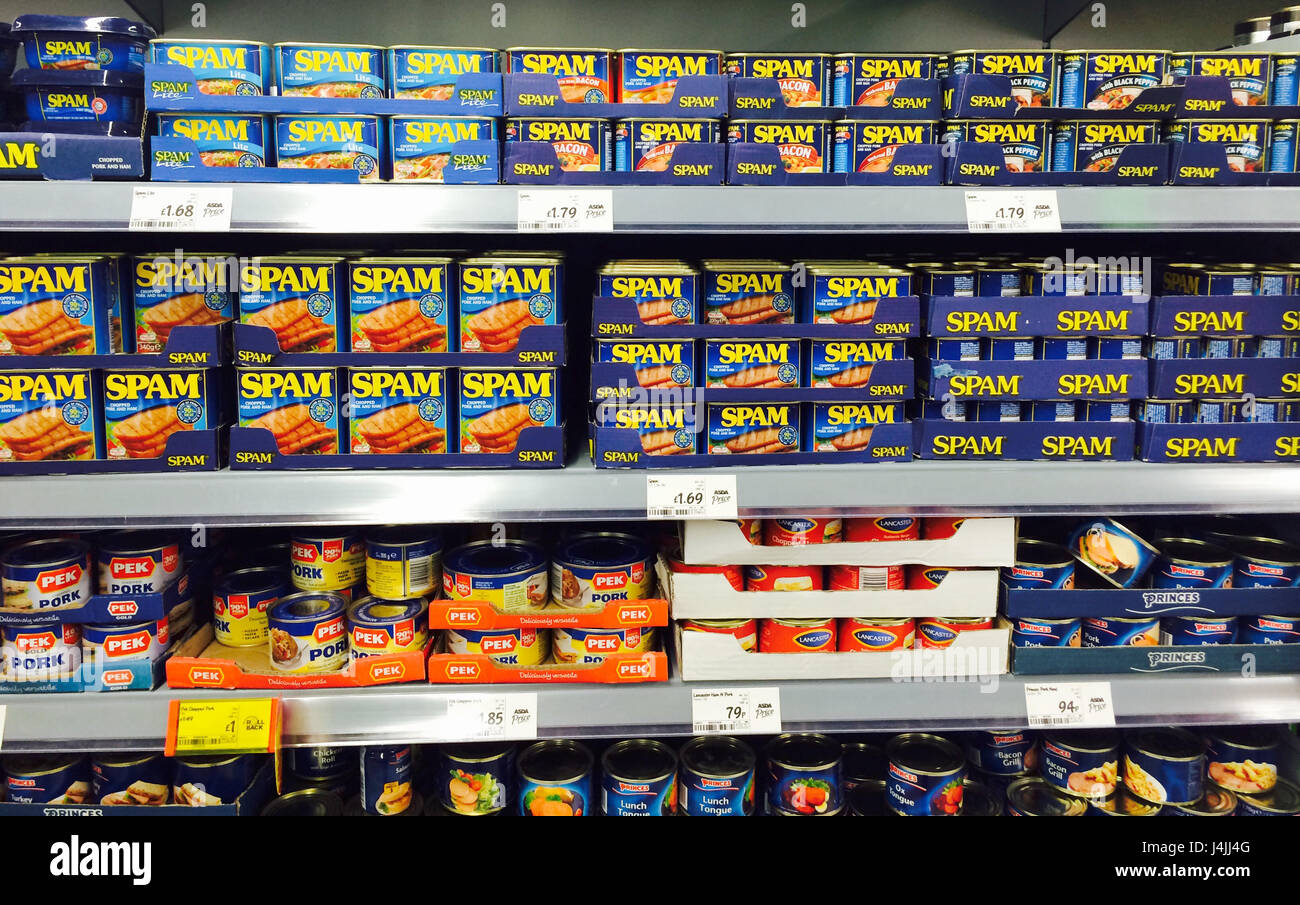 Tins of Spam on a supermarket shelf in Asda - Stock Image