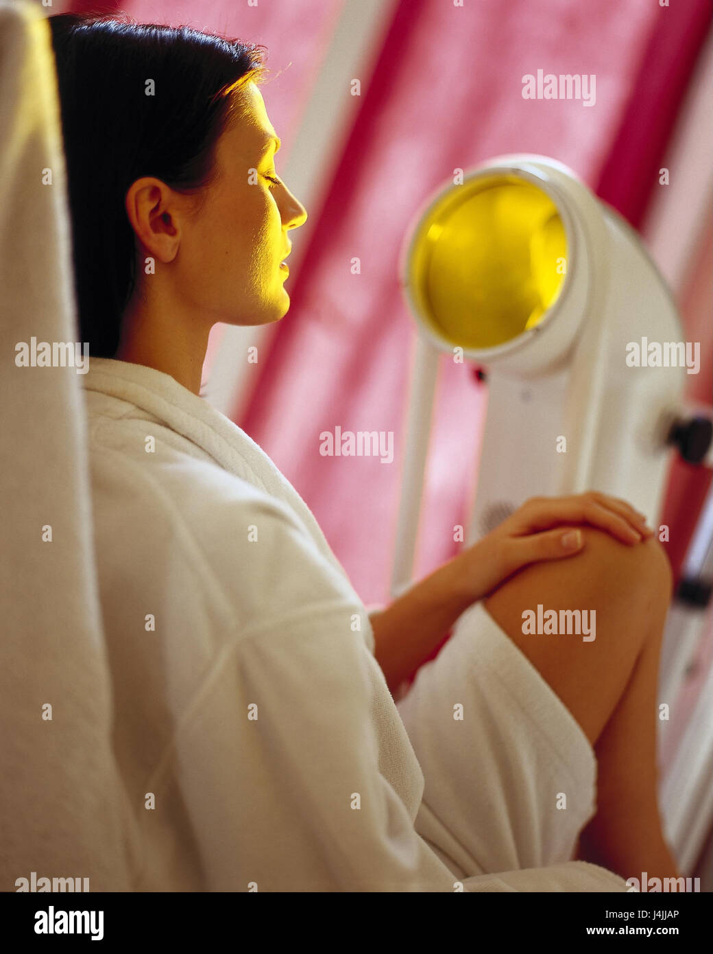 Treatment chair, Bioptron lamp, woman, look, irradiate inside, young, biology light therapy, light therapy, treatment, - Stock Image