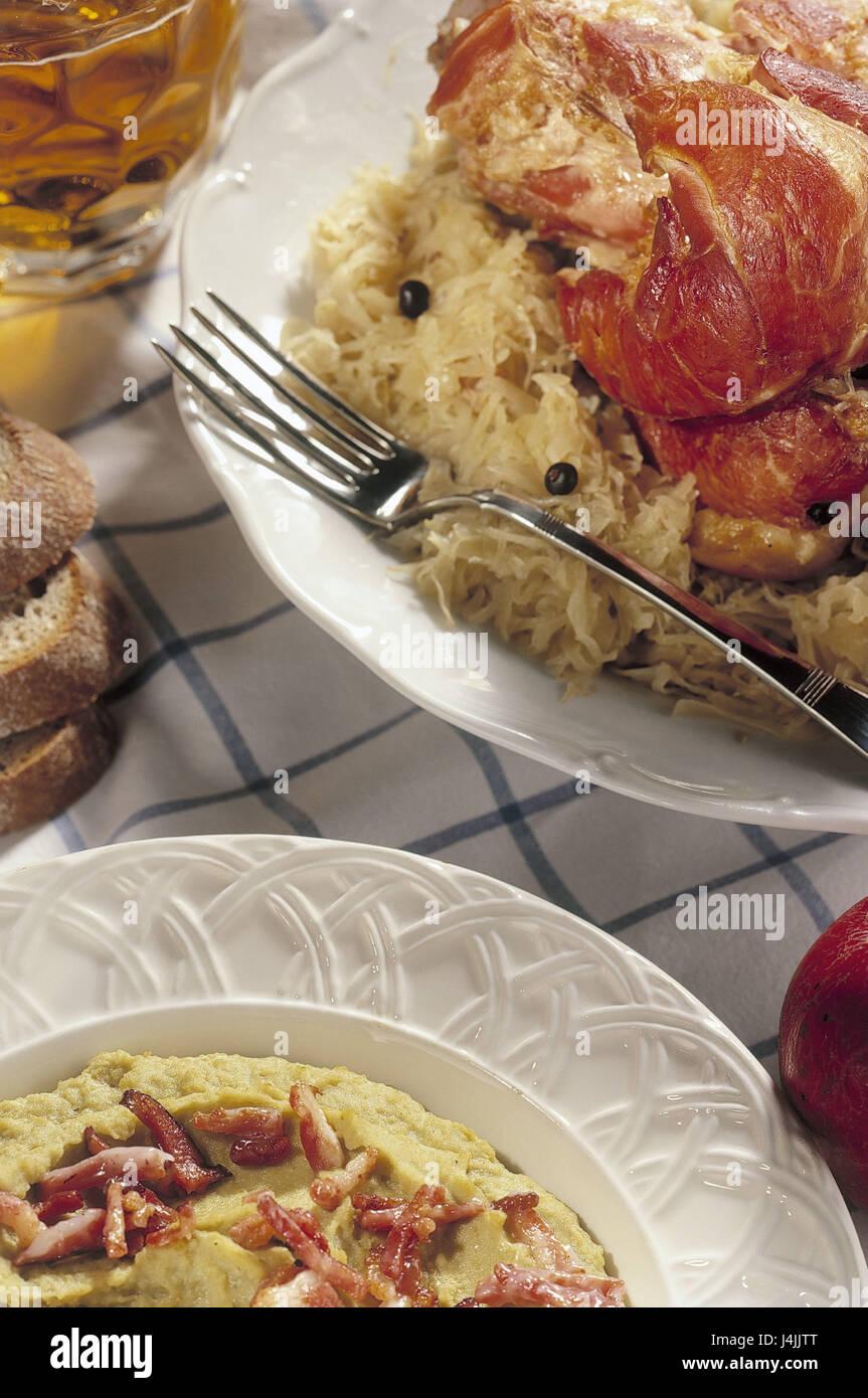 Meat course, pork knuckle, sauerkraut, pureed peas food, food, food, plate, food, meat, meat course, food, meal, - Stock Image