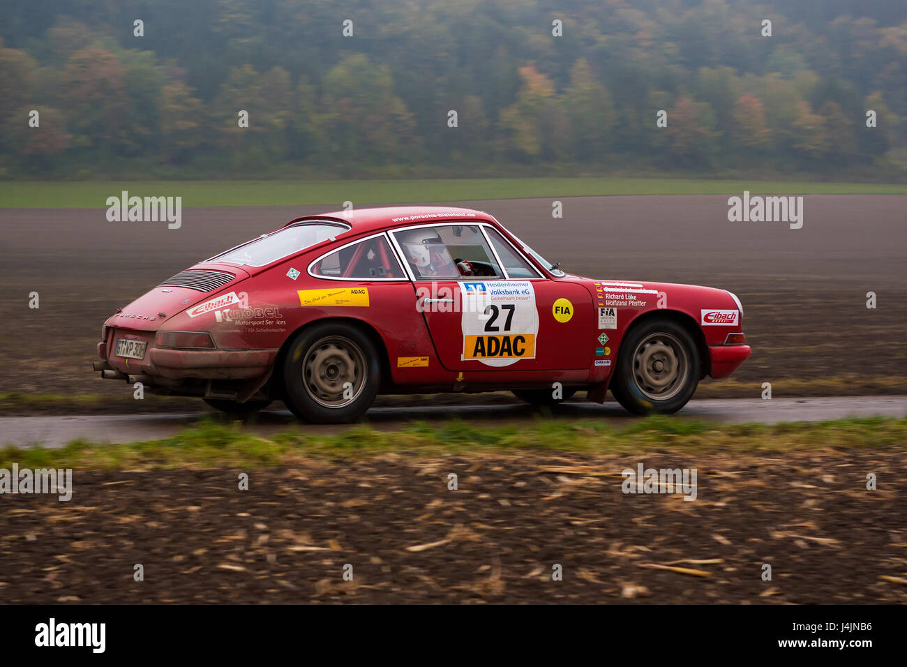 FLEINHEIM, GERMANY – OCTOBER 5, 2013: Wolfgang Pfeiffer and Richard Lüke driving their Porsche 911T at the - Stock Image