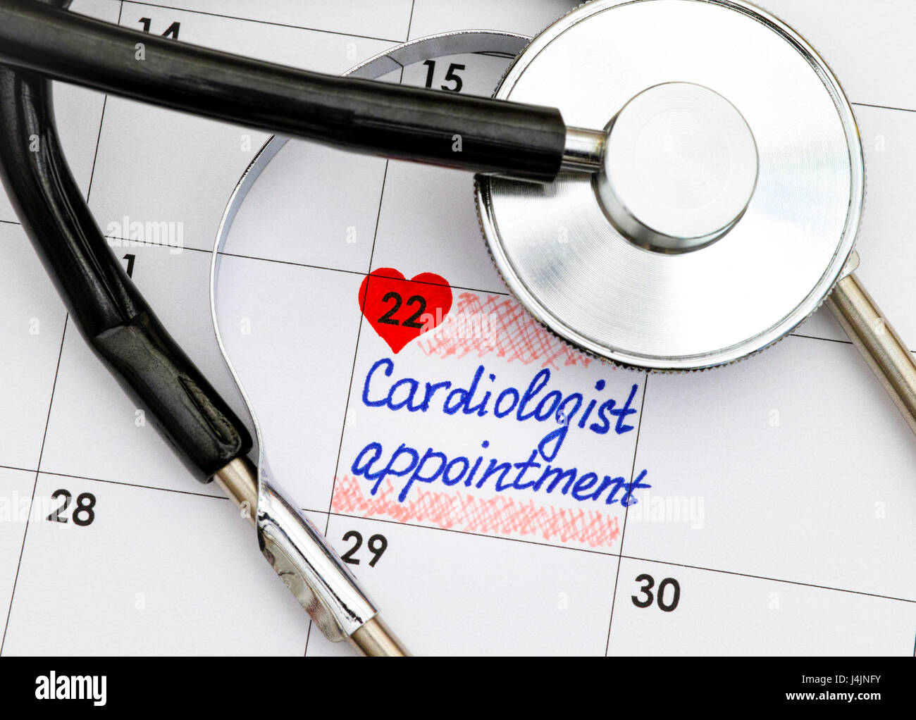 Reminder Cardiologist Appointment in calendar with black stethoscope. - Stock Image