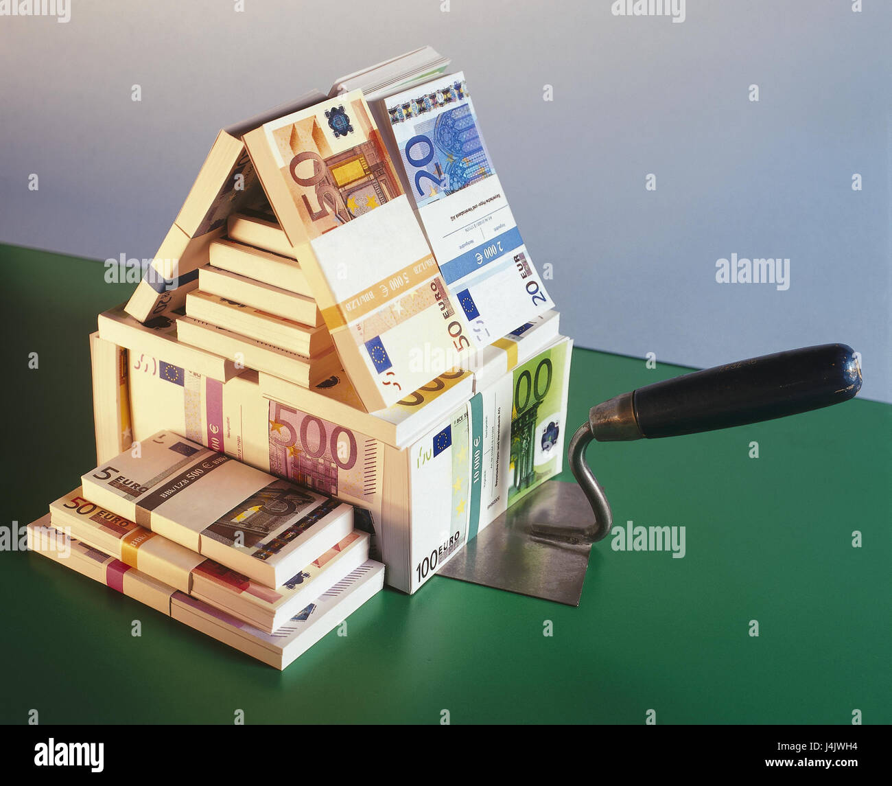 Icon building cost bank notes object photography still for Save money building a house