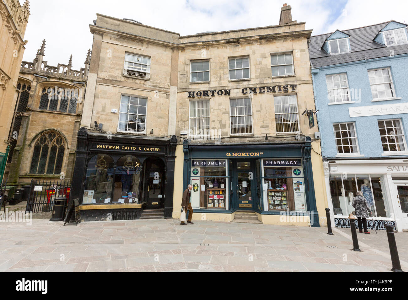 Pakeman Catto & Carter, Men's clothing store, and Horton Chemist and  Pharmacy at Market Place, Cirencester, - Stock Image