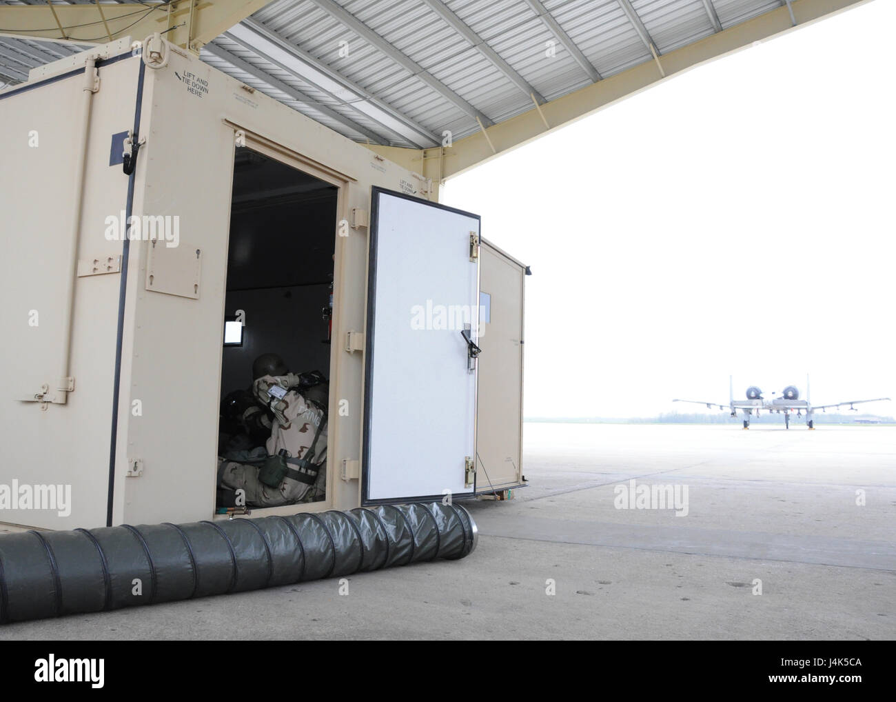 Airmen of the 442d Maintenance Squadron take cover in a