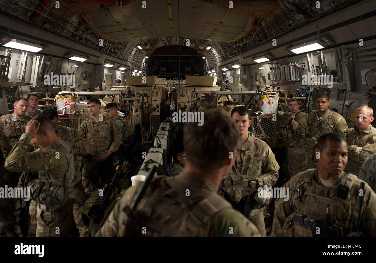 U.S. Army Soldiers assigned to the 82nd Airborne Division, Fort Bragg, N.C., await instructions during Jade Helm Stock Photo