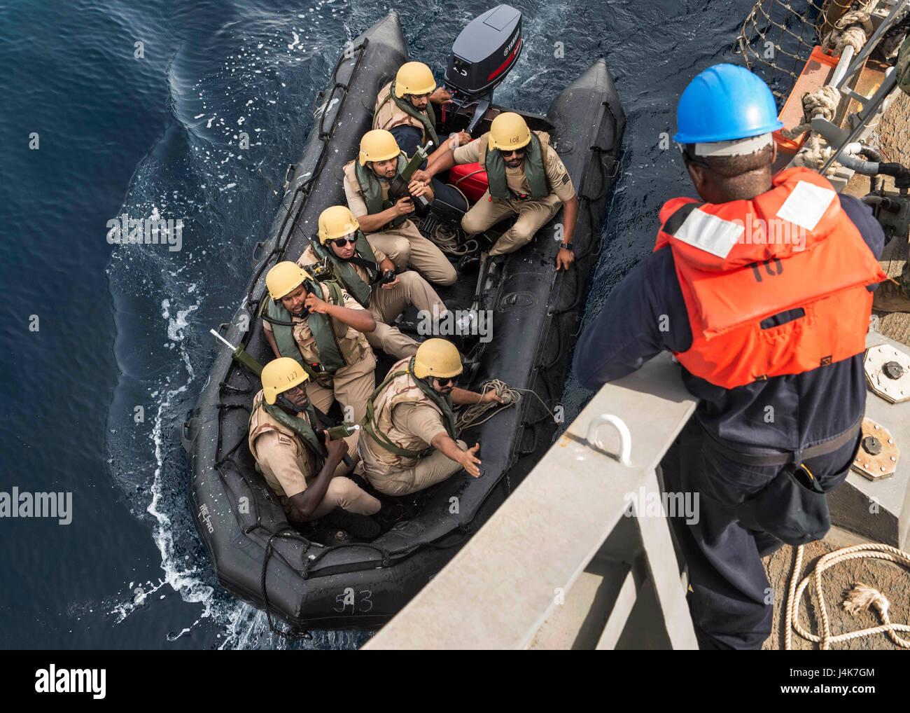 ARABIAN GULF (May 3, 2017) Royal Saudi Navy Sailors pull alongside USS Mahan (DDG 72) as they prepare to board the - Stock Image