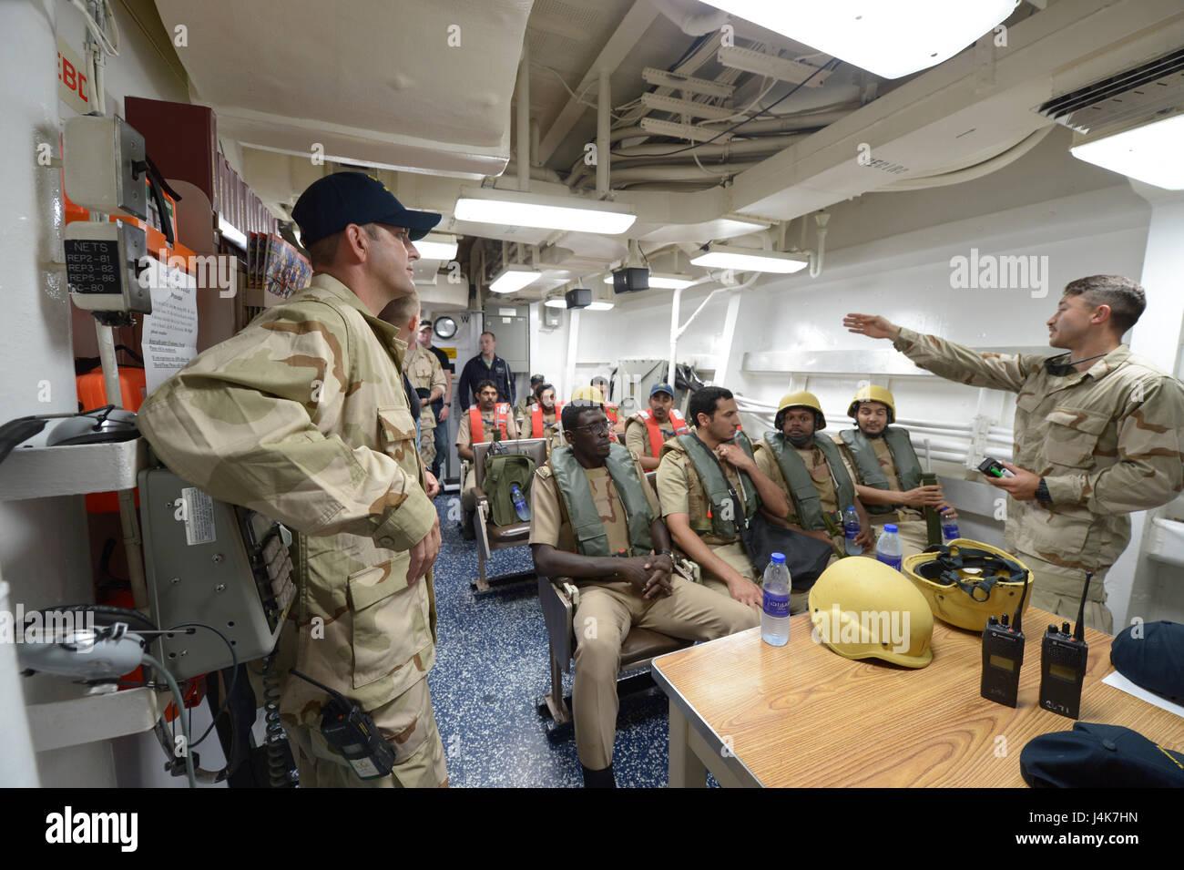{170503-N-VC432-0094} ARABIAN SEA, Saudi Arabia (May 03, 2017) – Ens. Jose Benitez, USS Mahan (DDG 72), leads a - Stock Image