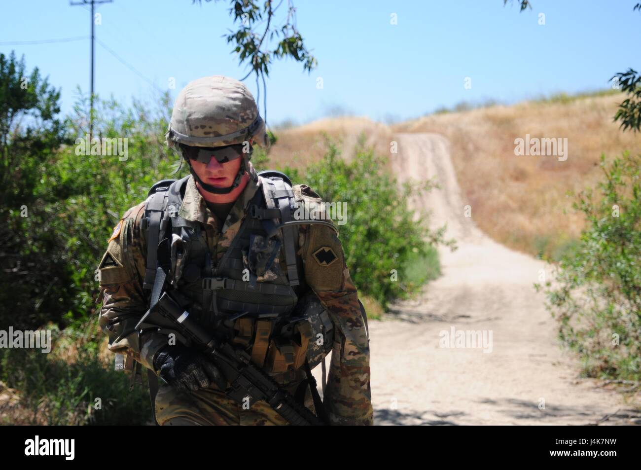 sgt brandon blue a horizontal construction engineer with the 786th quartermaster company conducts a 62 mile ruck march during the best warrior