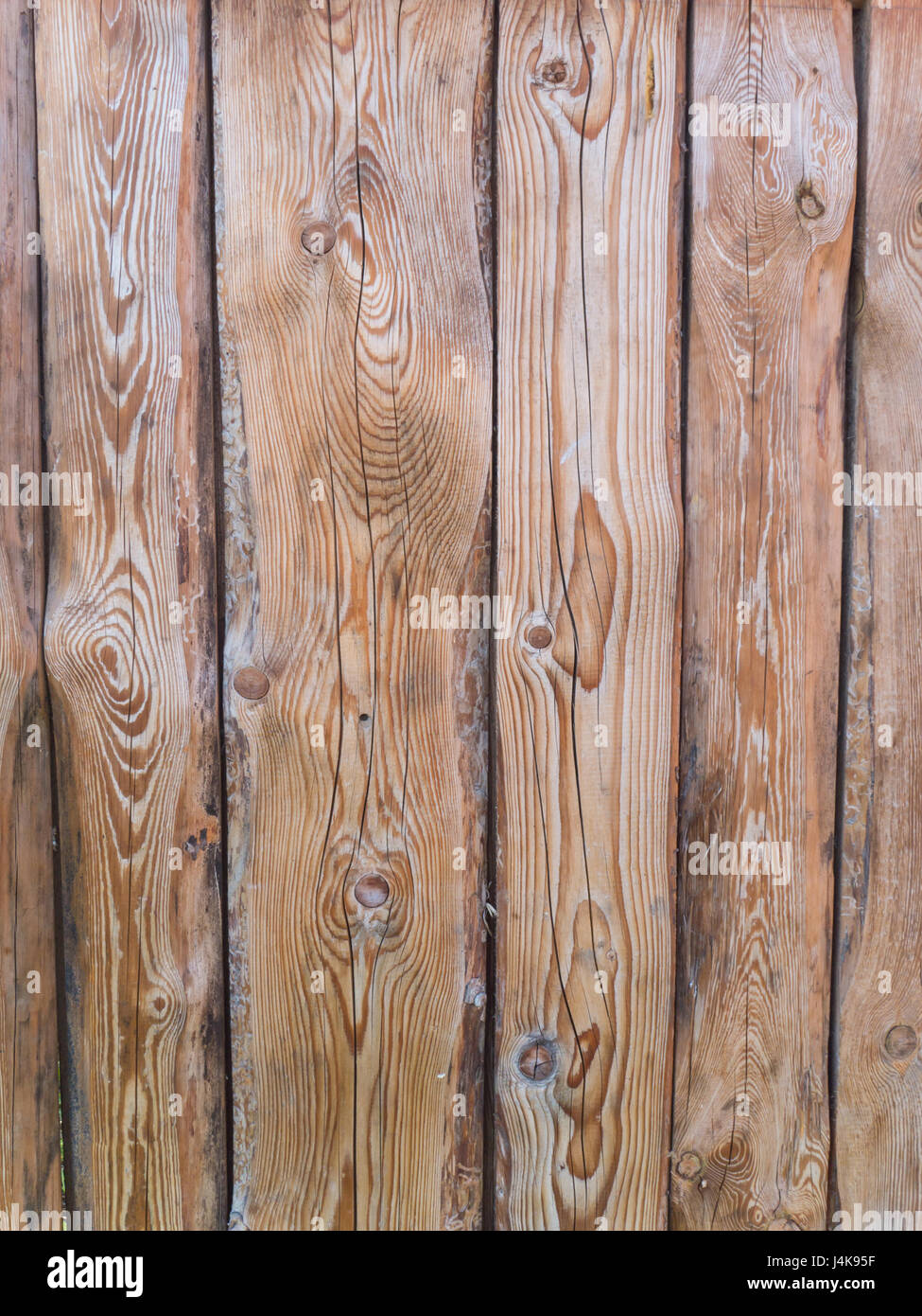 Wooden textured planks with cracks and holes background - Stock Image
