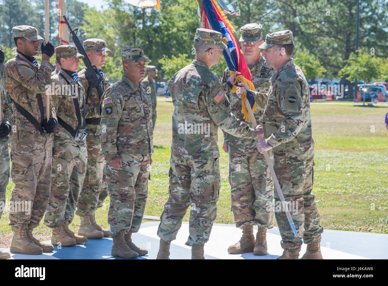 Gen. Robert Abrams, right, Commanding General of U.S. Forces Command, passes the division colors to incoming commander, - Stock Image